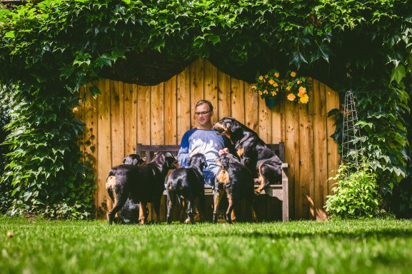 Erik surrounded by his 6 rottweilers. (Photograph by Jure Vukadin)